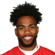 Charcandrick West catches one pass before exiting with possible concussion photo