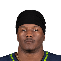 Chris Carson has fractured hip photo